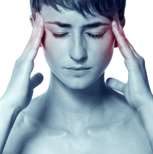The young attractive woman with an awful migraine. A headache attack